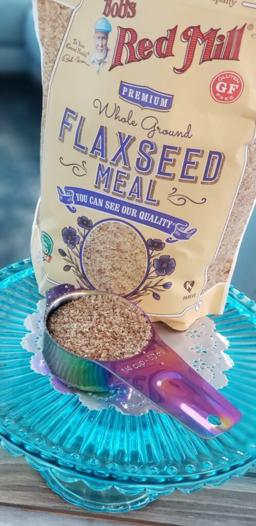 flax seeds bag filled with a spoon of flaxseed in front