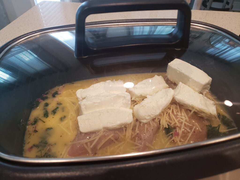 crockpot with chicken - sauce and cream cheese