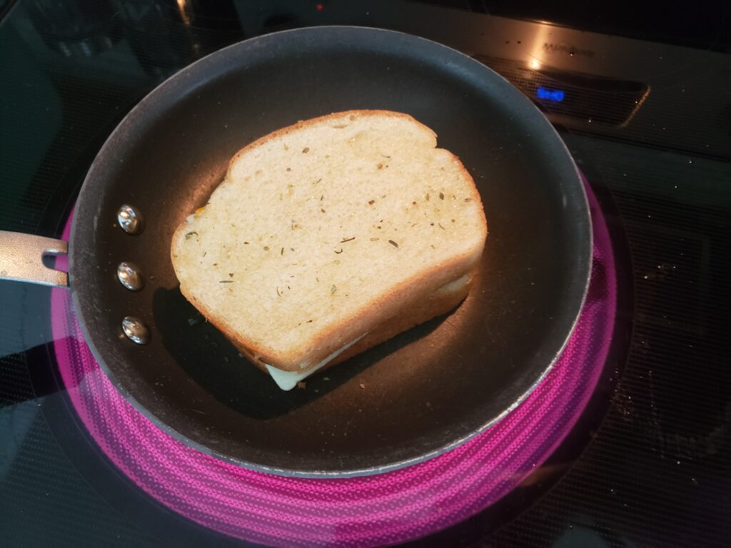 grilled cheese in a pan with spices on top of it