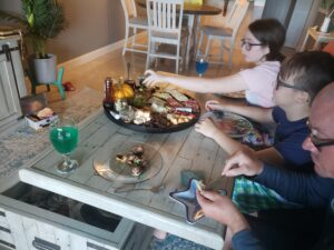 charcuterie board and family