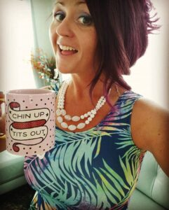 woman holding coffee cup with a smile