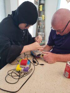 a man and a boy fixing a tetris game